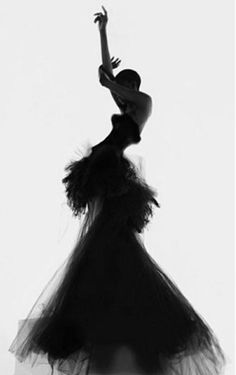 Dramatic Model Pose creating a striking silhouette in a Versace dress; photoshoot idea // fashion photography by Nick Knight