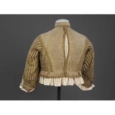 Doublet Place of origin: Britain, United Kingdom (made) Italy (woven) Date: 1650-1665 (made) Artist/Maker: Unknown (production) Materials and Techniques: Silver-gilt silk tissue, trimmed with silver-gilt bobbin lace, lined with silk taffeta and reinforced with linen, hand-sewn with silk and linen thread Credit Line: Purchased with the assistance of The Art Fund, the Friends of the V&A, and a number of private donors Museum number: T.91-2003