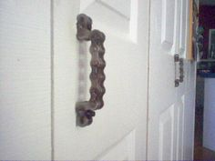 A cute and easy DIY project that my mom did for her laundry closet knobs. Instead of the traditional doorknobs, she used Harley motorcycle chains, and my Pawpaw welded them :) such a great idea for the biker in your family!
