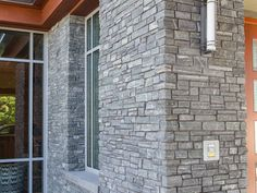 White Brick with Greenwich Gray Ledgestone Veneer Columns and Siding  What a great combination. More and more we are seeing different types of building materials used together in design. The Belmont Country Club utilized brick, stone, wood, and metal in a way that is both modern and sophisticated.