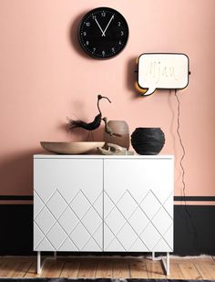 I could never get away with having a pink wall...but this is so cute.