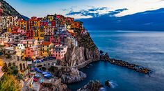 Cinque Terre, the rugged and colourful villages that stretch along the coast of Italy are a photographers dream. Go before the ticket system stops you!