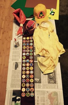 """My home made Russell from Up costume. I used 1.5"""" wooden discs and my printer to make the badges. Fabric glue made quick work of attaching them to the sash. The kerchief choker is a wooden napkin holder I found in the woodworking section of a crafts store."""