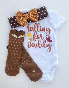 Your doll will be so cute in our Falling for Daddy Outfit now available with matching socks and bow!  Both the bow and the socks come with a super cute gold embellished heart. If you would like to customize with a name or monogram instead, please shoot me a message.  The headband measures approx. 16 and should fit about 3 months and up. It is super stretchy and will fit your little girl for a long time to come!  The brown fox knee highs come in 2 sizes: 0-1 Year or 1-3 Years. Please leave…