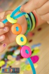 Pipe cleaner and button bracelets were a creation of my daughter. Knowing this c… Pipe cleaner and button bracelets were a creation of my daughter. Knowing this craft is simple and inexpensive I knew my audience would love it –… Continue Reading → Crafts For Girls, Crafts To Do, Diy For Kids, Easy Crafts, Button Crafts For Kids, Simple Kids Crafts, Crafts With Buttons, Crafts With Pony Beads, Simple Craft Ideas