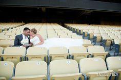 Baseball wedding bride and groom stadium photo