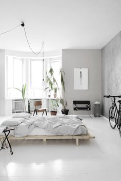 Light bedroom with a concrete wall - via Coco Lapine Design blog