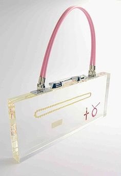 Ted Noten. Object: Paraphernalia, 2007. Pearl necklace, 0,25K diamond, cocaine, Kabbalah string, cross. 20 x 46,7 x 3,7 cm. Www.20ltd.com.