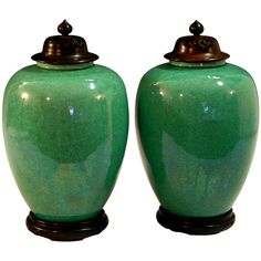 Pair Awaji Ginger Jars  Japan  Circa 1920's  Pair Awaji pottery ginger jars in green crackle glaze with hardwood stands and covers.  Impressed export and kiln marks.