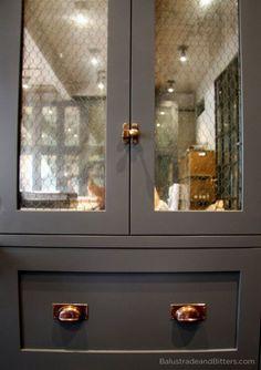 Matte gray cabinet, chicken wire glass, brass hardware :: eye spy: design + decor to delight + inspire
