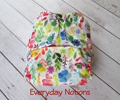A personal favorite from my Etsy shop https://www.etsy.com/listing/400148111/cloth-diaper-watercolor-flowers-one-size