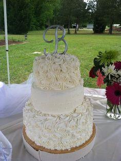 My first wedding cake. White cake cake with vanilla buttercream frosting. Delish!