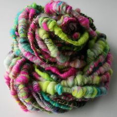 handspun from SpunRightRound  green , aqua , hot pink art yarn.