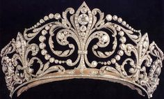 Fleur-de-Lys Tiara (aka La Buena). A wedding gift from King Alfonso XIII to his bride, Princess Victoria Eugenia. The Countess of Barcelona wore it to Queen Elizabeth II's coronation. Victoria Eugenia left it to her son, Don Juan; after his son Juan Carlos was proclaimed King, the Countess gave the tiara to her daughter-in-law, Sofia. Creator: Ansorena, 1906, Diamonds and Platinum.