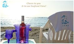 Seafront View with a glass of Wine at the Poseidonia Beach Hotel in Limassol Cyprus
