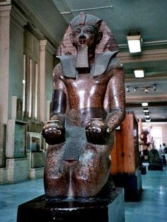 Colossus of Tutmosis III , Great Warrior , the Napoleon of Egypt . Red granite. New Kingdom, Cairo Egyptian Museum.