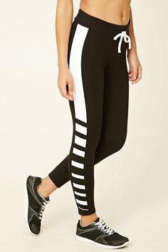 A pair of knit capri leggings featuring stripes and an elasticized drawstring waist.