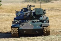 The Type 74 (74 nana-yon-shiki-sensha) is a main battle tank (MBT) of the Japanese Army. It was built by Mitsubishi Heavy Industries as a replacement for the earlier Type 61. It was based on the best features of a number of contemporary designs, placing it in the same class as the US M60 or German Leopard 1. Like these designs, it mounts the Royal Ordnance L7 105 mm gun. The design did not enter widespread use until 1980.