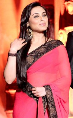 Grooming herself to be the Chopra bahu, Rani looks a vision in her red sari. Bollywood Designer Sarees, Bollywood Saree, Indian Bollywood, Bollywood Fashion, Bollywood Actors, Cheongsam, Hanfu, Indian Dresses, Indian Outfits