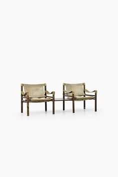 Arne Norell Sirocco easy chairs with side tables at Studio Schalling