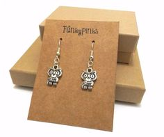 Twit-twoo! These are a cute pair of charm earrings shaped like owls!The charms are made with Tibetan silver, and measure approx 1 inch from top to bottom.The earrings are on silver plated hooks and dangle down about 1.5 inches from the earlobe.A rubber back will also be provided to hold them in place.The earrings will arrive, in a glitzy organza gift bag.Check out my shop for lots of other animal charm jewellery!
