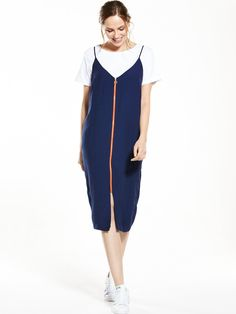 V by Very Zip Front Slip Dress - Navy This sporty littleslip dress from V by Very is all about the easy-going athleisure vibe. Taking its cues from the season's favouredcamislips, its dainty design features a V-neck and adjustable spaghetti straps - all streamlined with a contrast orange zip-down frontfor a statement colour pop. Styling Ideas Layerthis dress over a basic tee with trainers to nail cool off-duty style from city-dwelling days to Sunday brunch.