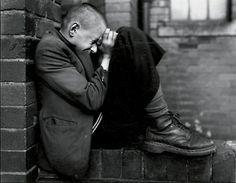 Chris Killip, Youth on wall, Tyneside, 1976
