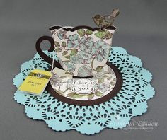 handmade easel card ... luv the shaped teacup and the doily base ...