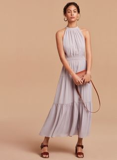 Style this flowy dress with a colorful belt or bold stilettos for a beautiful springtime look.