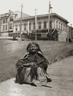 """Popularly named """"Princess Angeline"""" Chief Seattle's daughter rests on the boardwalk descending on the south side of Pike Street west of First Avenue in the early 1890s and years before there was any Pike Place."""