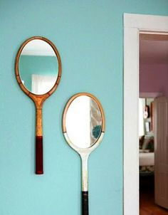 Antique or old tennis rackets---glue a cheap mirror on it and hang on the wall! LOVE!