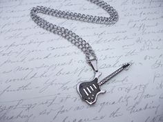 Guitar pendant necklace for the music lover ! Mad of a very good quality stainless steel guitar pendant with nice details on a wide stainless steel chain. 45 mm long guitar pendant 20 in. Steel Guitar, Stainless Steel, Personalized Items, Etsy, Design, Guitar, Pendant, Necklaces, Music
