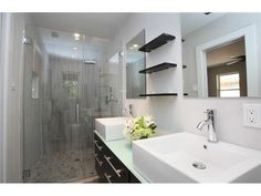 Clean bathroom // Square vessel sinks // Floating shelves // Glass shower with gray tile