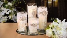 Glass cylinders with lace, rhinestones, pearls