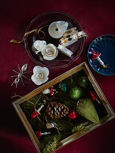 Tree decorations and ribbon in bowls and boxes on a table. Tree decorations and ribbon in bowls and boxes on a table. Ikea Christmas, Christmas Hacks, Christmas Gifts, Christmas Traditions, Christmas Themes, Christmas Decorations, Ikea 2018, Plum Walls, Germany