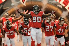 Through smoke, fire and cheers, the Falcons enter the field for every home game at the Georgia Dome and we're looking back at our favorite entrance photos of 2013 Nfl Football, Football Helmets, Atlanta Falcons Memes, Photo Galleries, Logo, Logos, Environmental Print