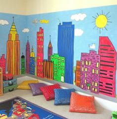 Instead of city paint an outdoor scene to make the basement playroom feel more free