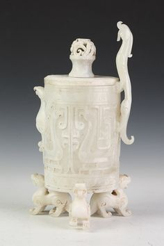 CHINESE ARCHAISTIC WHITE JADE VESSEL. Of cylindrical-form, carved with phoenix bird and dragon-form finial - 12 3/4 in. high.  Notes: PROVENANCE: Estate of a European Collector, Washington, D.C.