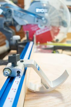 The Kreg Trak swing stop can hold down boards while cutting, and also can be used to measure cuts from the left side of the miter saw blade.