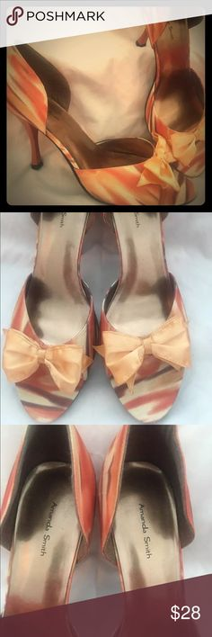 Women's Orange D'Orsay Heels Amanda Smith Sz 10 Gorgeous pair of high heel hard to find Orange D'Orsay pumps! They are hot, hot, hot!! There is little to no signs of wear, as these have only been tried on and never worn. There is a cute little bow on the toes. There is one spot on the bow of the right shoe that looks like a glue spot (came from factory this way) that you don't even notice when they are on! Please see pics--they are close ups and show how great these pumps are! Heel height is…