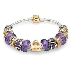 Gold and Purple Gold Chamilia Snap bracelet.