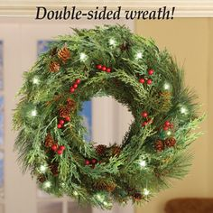 Double Sided White LED Evergreen Wreath - beautiful from every angle! Hang in your front windows so it can be enjoyed from both inside and outside your home!