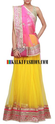 Buy Online from the link below. We ship worldwide (Free Shipping over US$100)  http://www.kalkifashion.com/half-and-half-lehenga-saree-in-pink-and-yellow-embellished-in-stone-and-gotta-patti-only-on-kalki.html