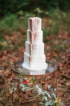 Elegant painted white tiered wedding cake