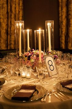 Linear elements of these tapers and votives complement the Art Deco theme of this elegant wedding. #WeddingCenterpieces