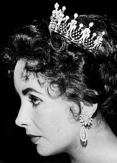 damelizabeth:  Elizabeth Taylor wearing the antique diamond tiara given to her by her husband Mike Todd, 1957.