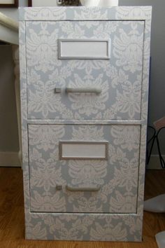 House Pretty Blog: Wallpaper your filing cabinet  *What I don't want the cabinet to look like.. must be careful with too much pattern wallpaper