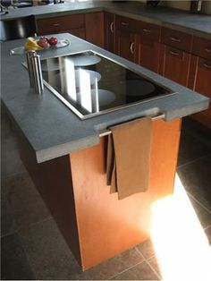 small pic but concrete countertops with built in hot plate ...