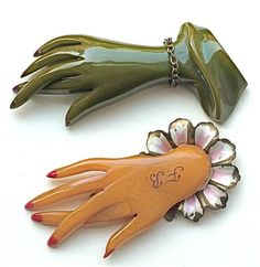 "Bakelite Hand Brooches  Someone admonishes the readers here, ""...never know whether to trust a crossed fingers hand pin.""  So, Topo wonders, ""Are we viewers NOT to trust a promise made by the giver of such a gift to us? or NOT trust that this is really a Bakelite product?"" Do tell me how to understand this."