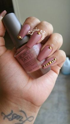 Must have mauve by Morgan Taylor. Coffin nails with gold studs. I'm in love with this color. Matte top coat by opi. Follow on instagram at naildbycassiechaos or on Facebook at Cassie Rey
